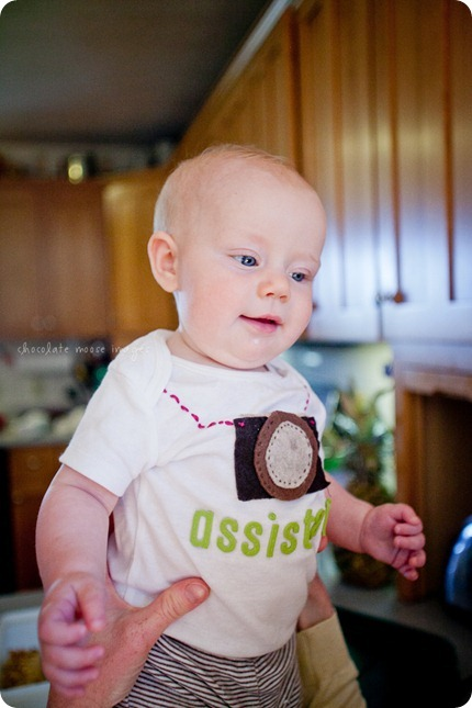 Little Charlotte models the assistant onesie showing her excitement to assist Chocolate Moose Images
