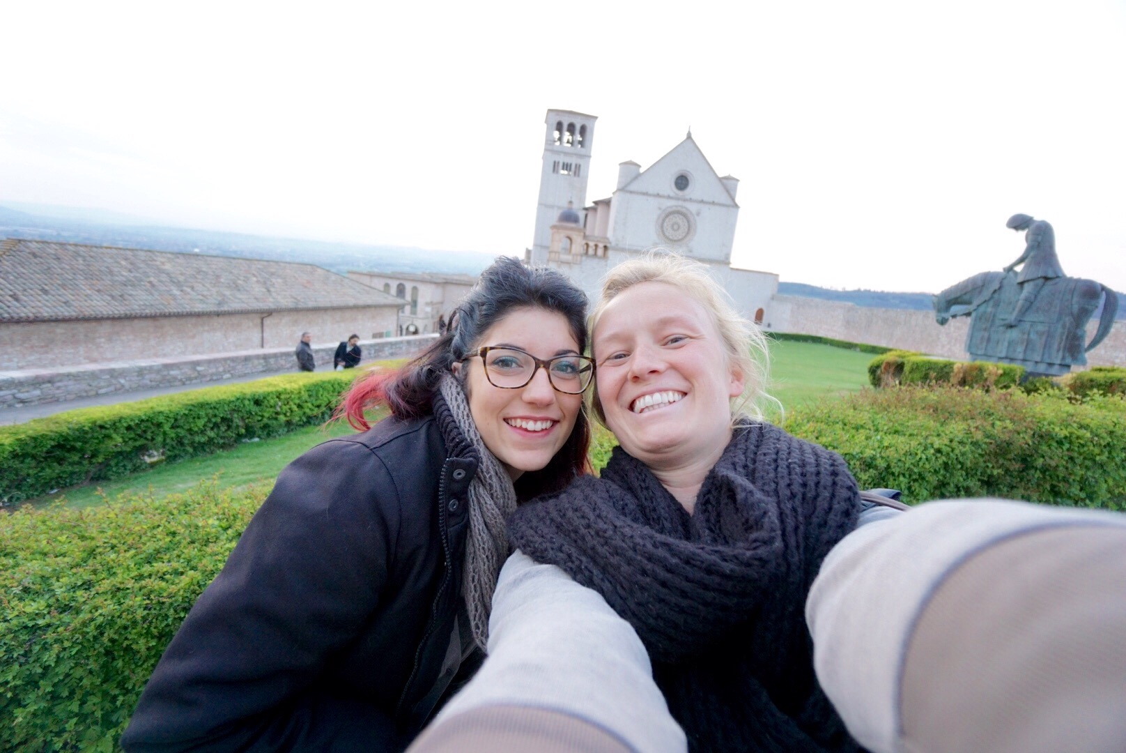 a self portrait of Angelica and Jess in Assisi in front of the basillica de san fernando
