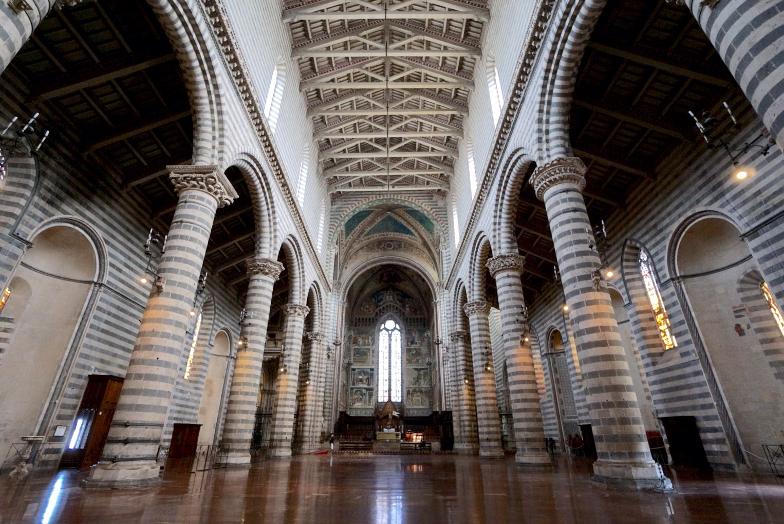 inside the duomo of Orvieto showing off its stripes